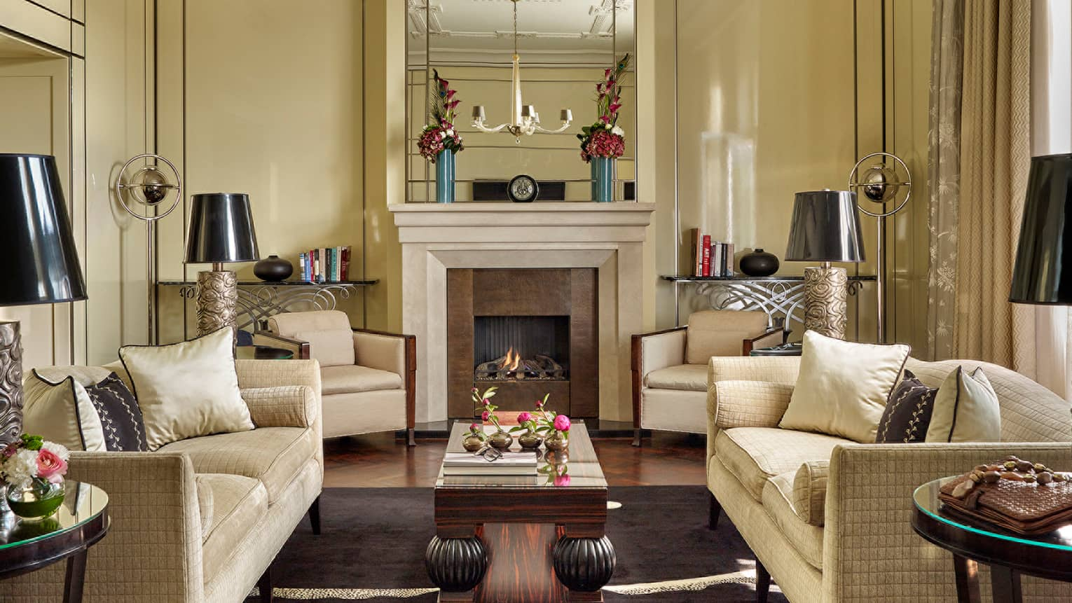 Budapest Royal Suite with cream sofas and armchairs around fireplace mantel
