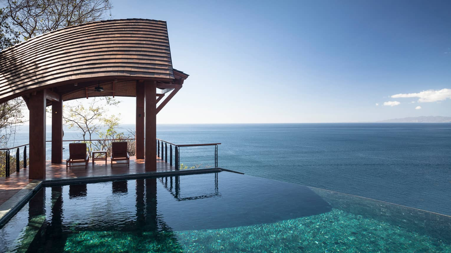 Casa de la Luna Residence Estate curved wood cabana over private patio, plunge pool, ocean and blue sky