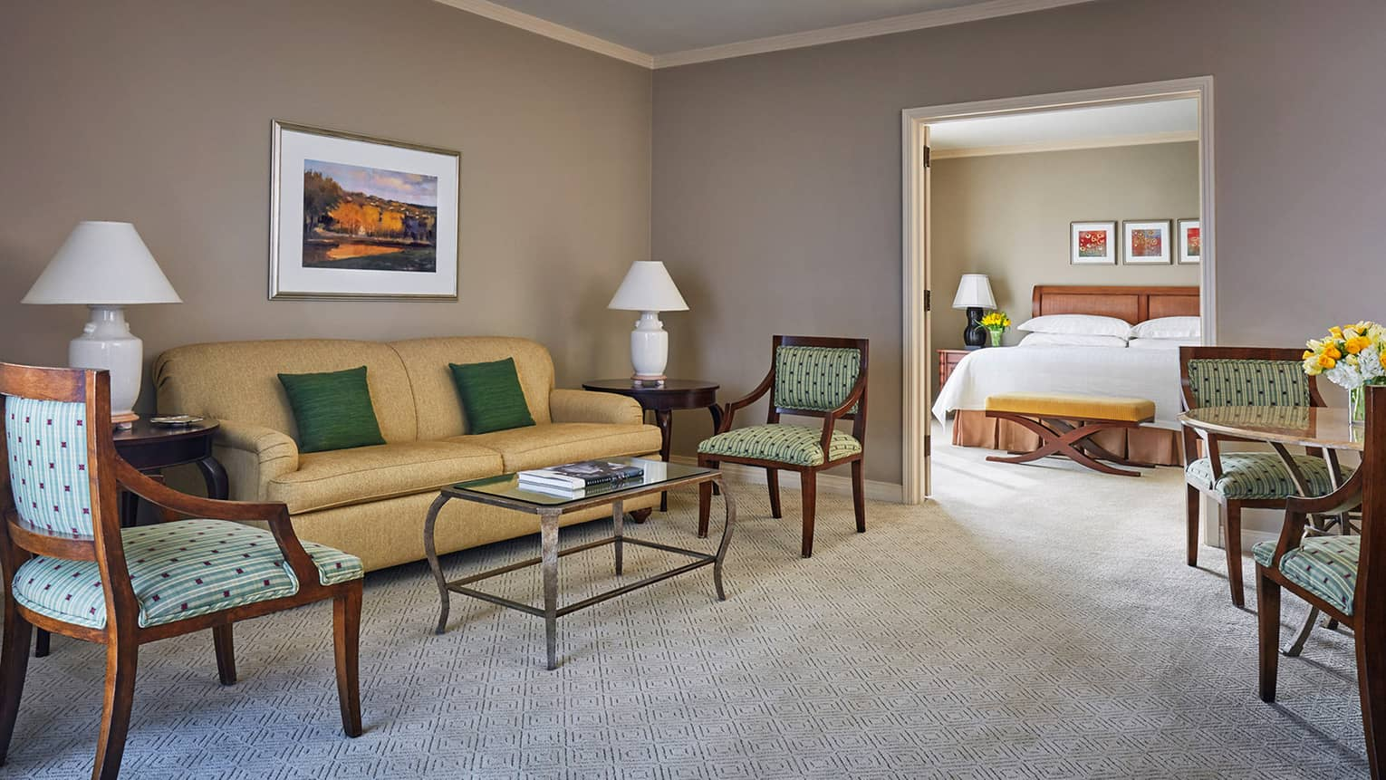 Four Seasons Executive Suite beige sofa, accent chairs, table by door to bedroom