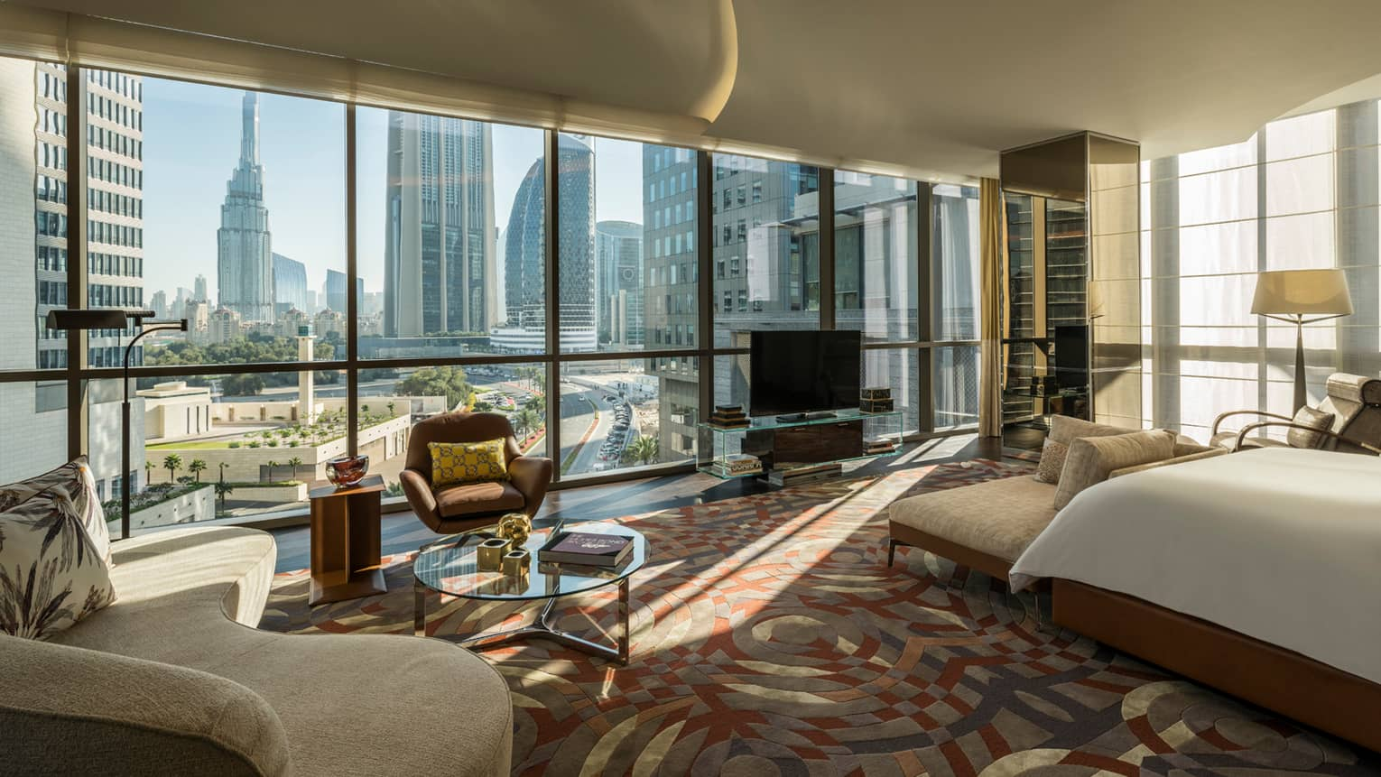 Bright Penthouse Suite with bed, sofa in front of wall of floor-to-ceiling windows with Dubai city views