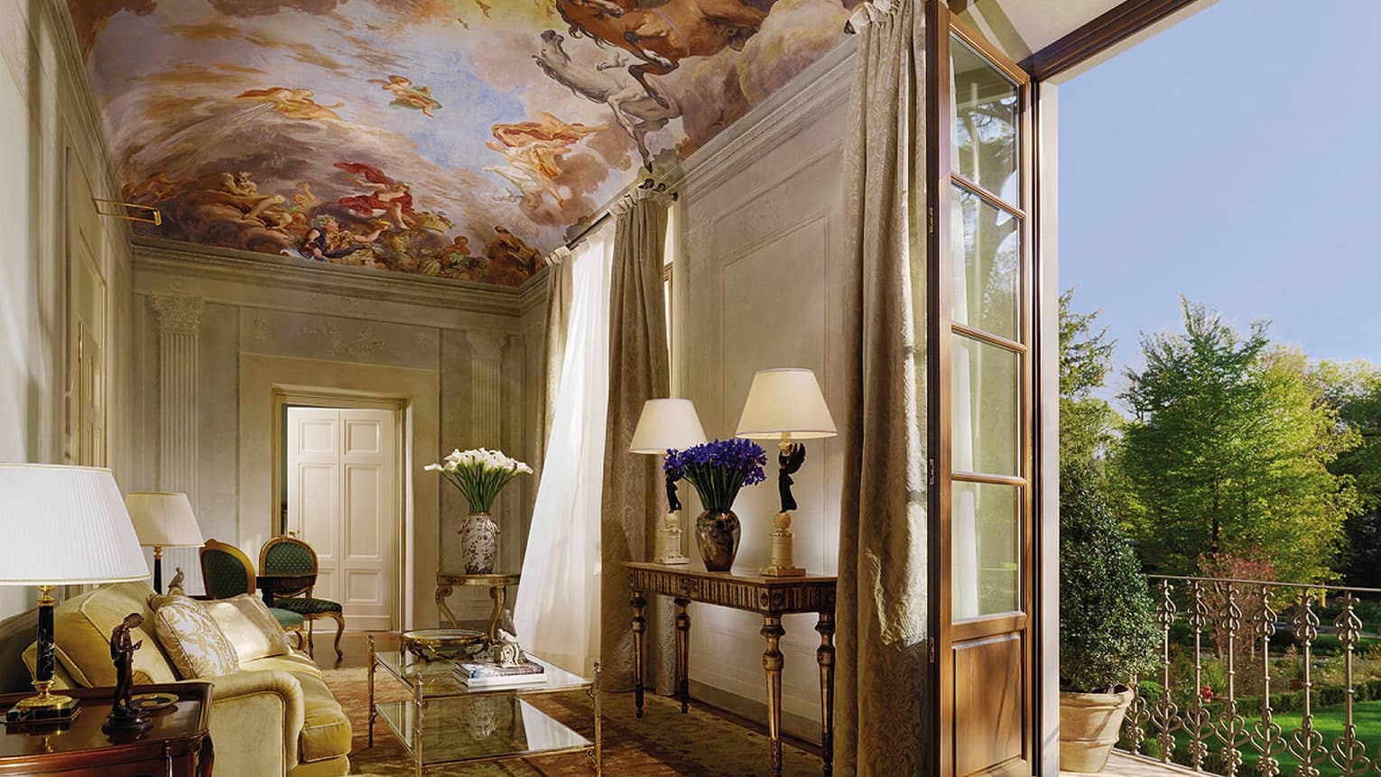 Presidential Suite sitting area under mural panel ceiling, open balcony door