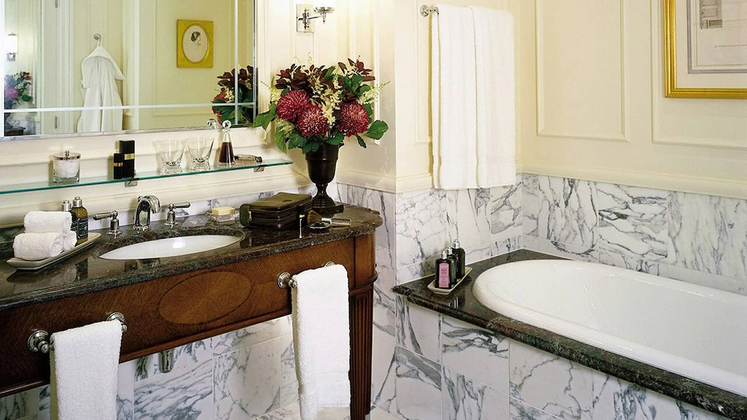 Mews Room white-and-grey marble and dark wood bathroom, sink, tub