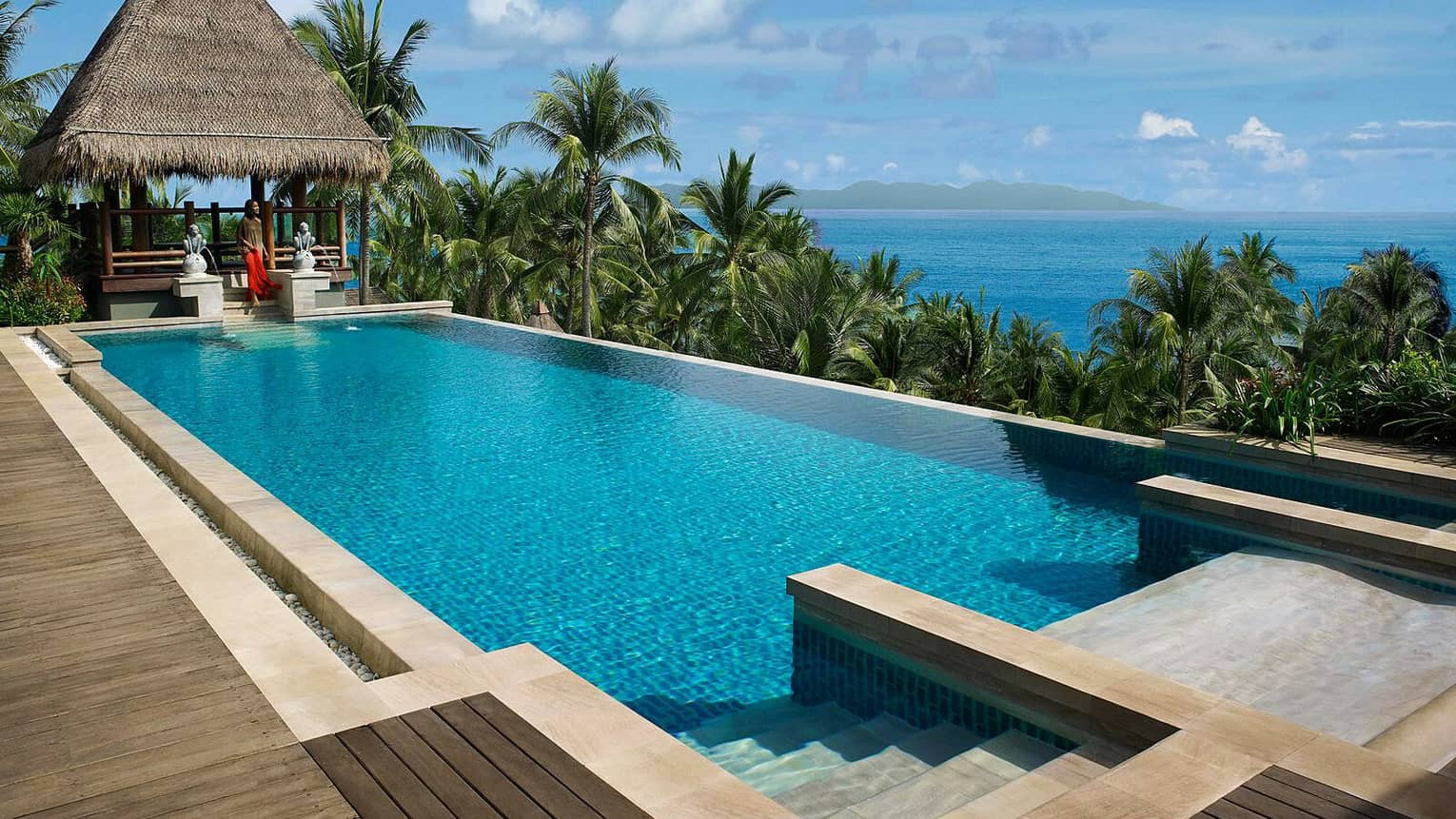 Five-Bedroom Residence Villa with Pool on sunny deck, cabana with thatched roof, ocean view