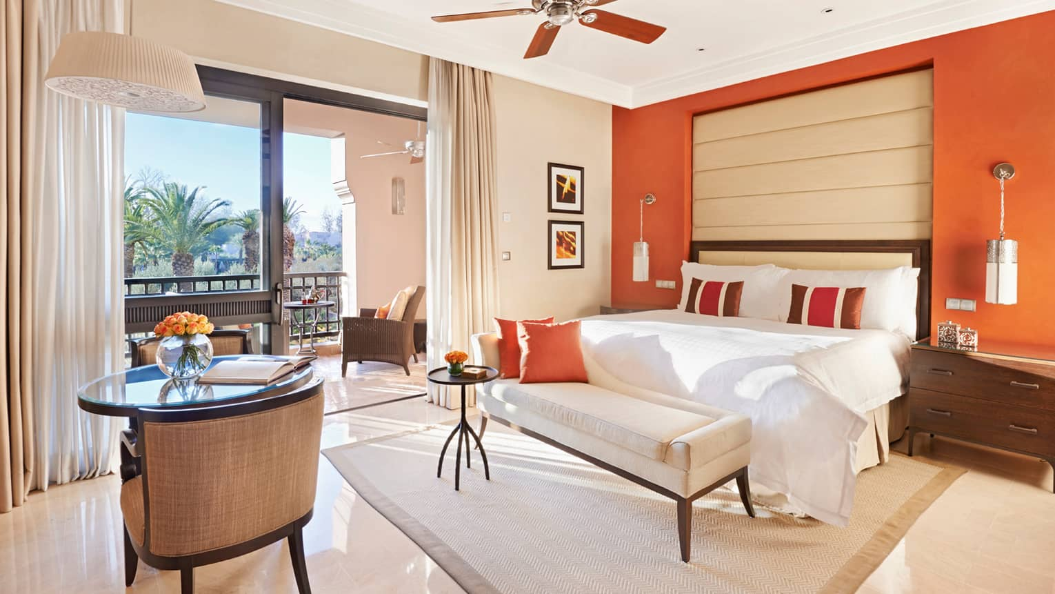 Garden-View Terrace Room with orange wall, white tile floors, fan above bed, large patio door