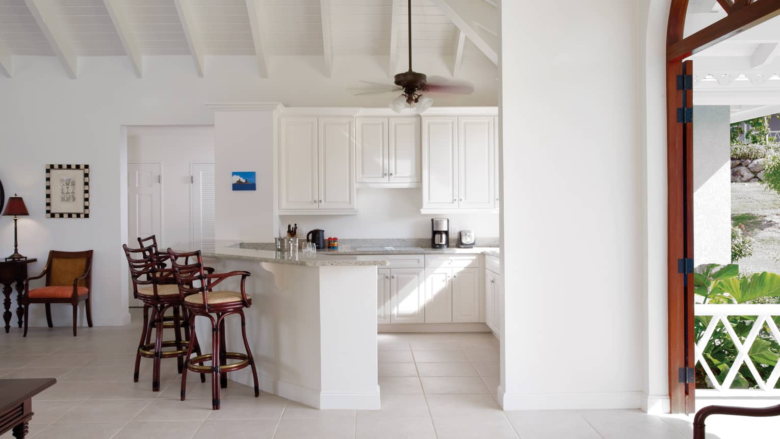 Sunset Hill Residence Villa white kitchen, wood stools at counter
