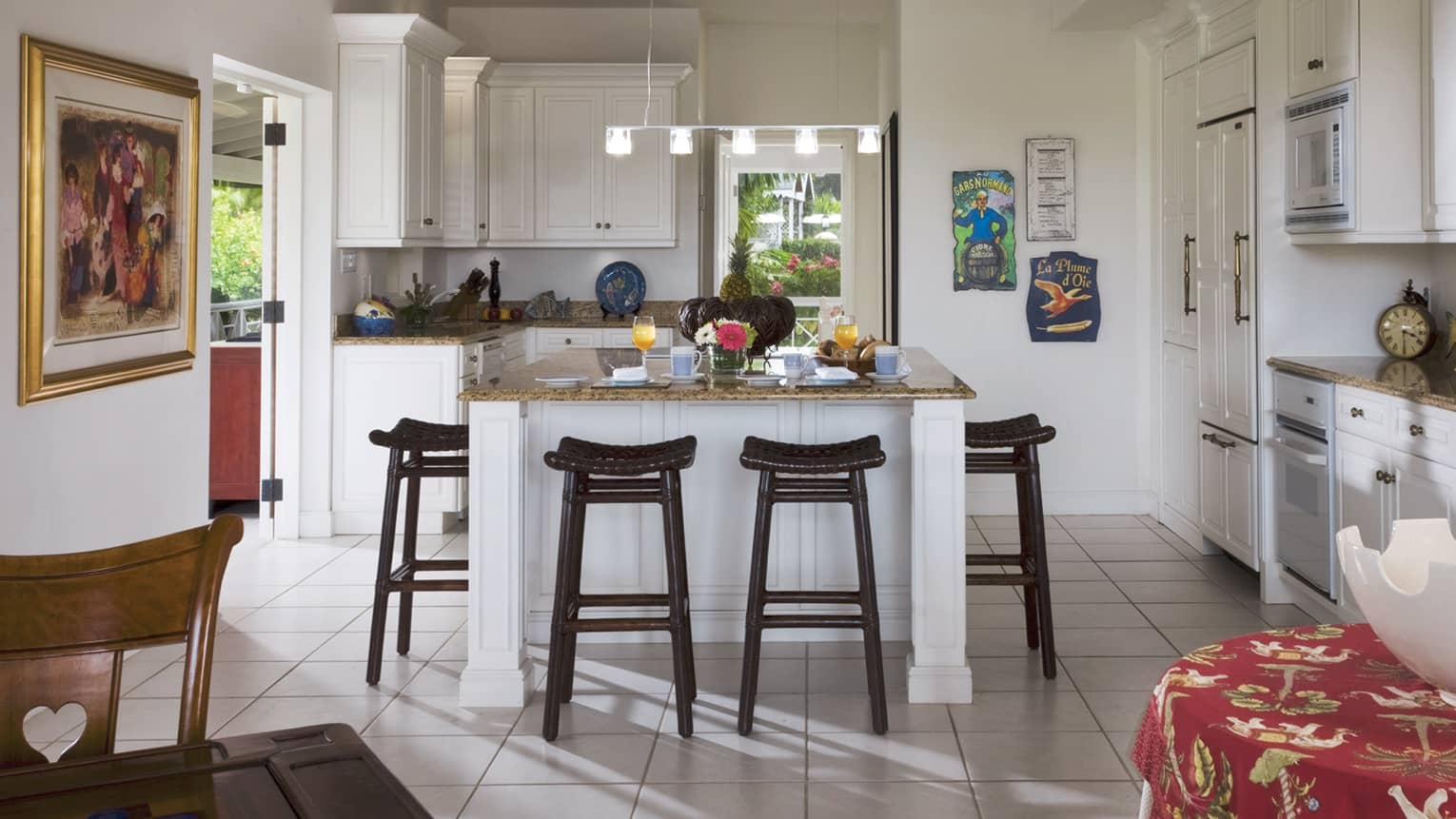 Palm Grove Residence white kitchen, island counter lined black stools