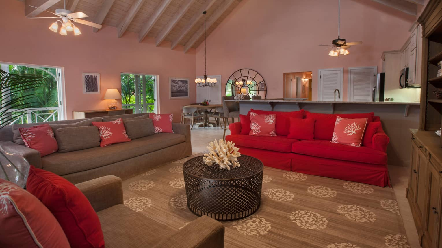 Residence living room, red, brown sofas under soaring wood beam ceilings