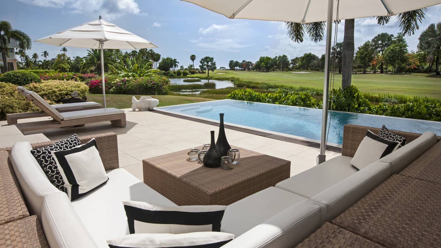 Palm Grove Residence Villa L-shaped patio sofa, cushions by plunge pool