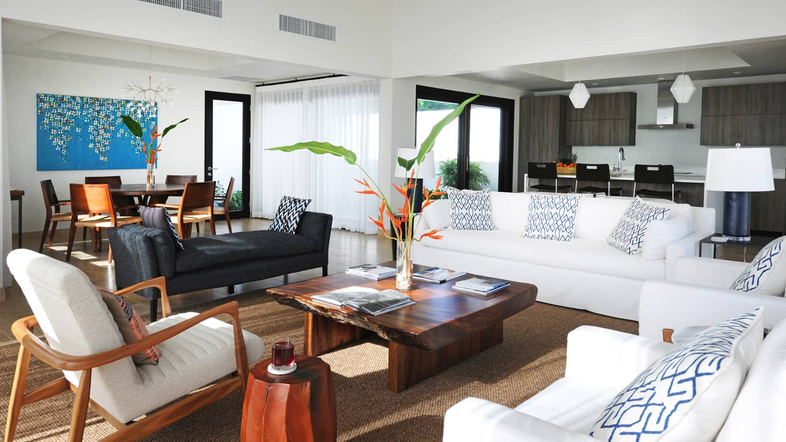 Pinney's Beach Residence Villa living room with white sofas, chairs, rustic wood table