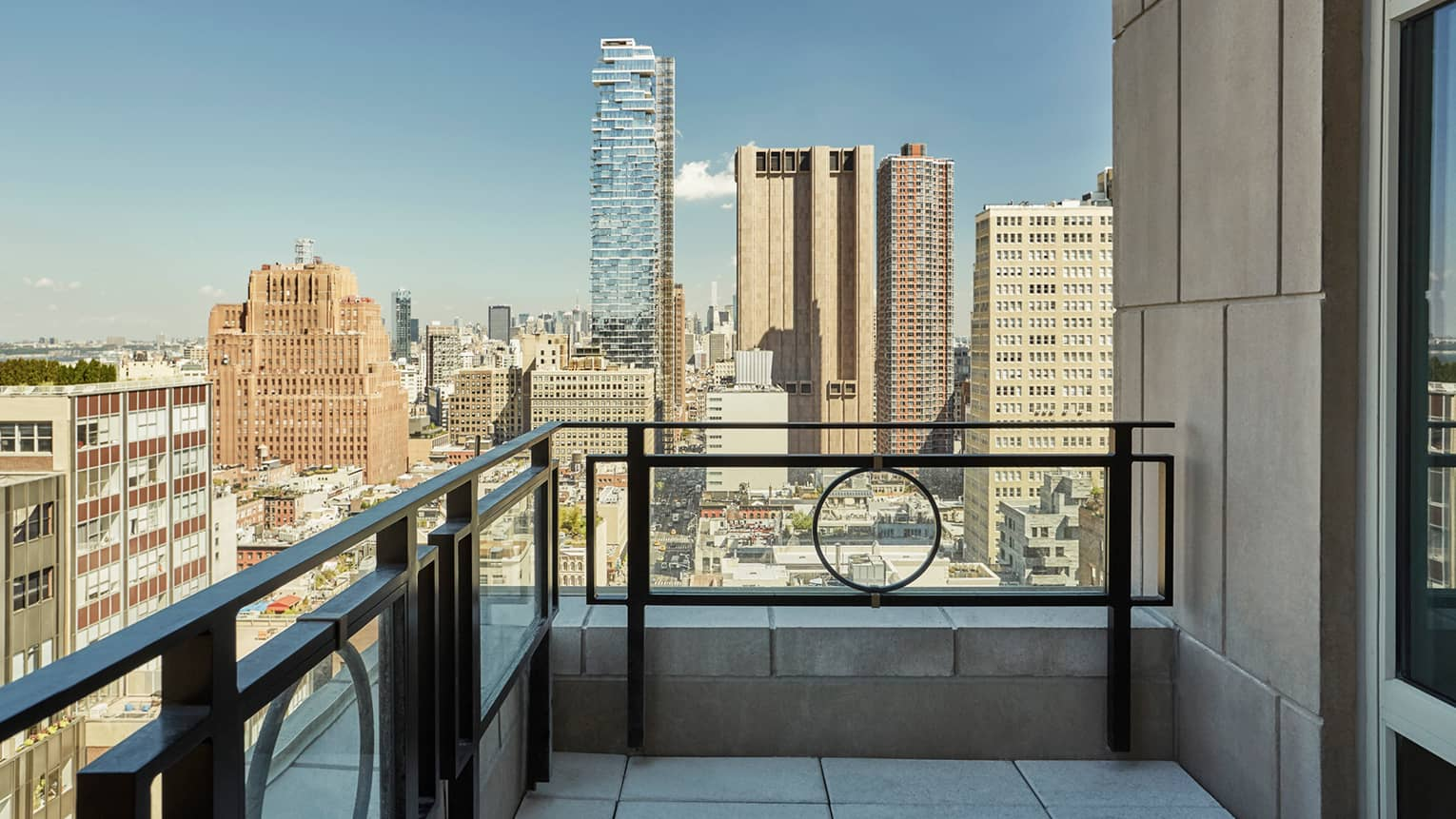 Hotel suite balcony overlooking downtown New York City buildings, skyscrapers