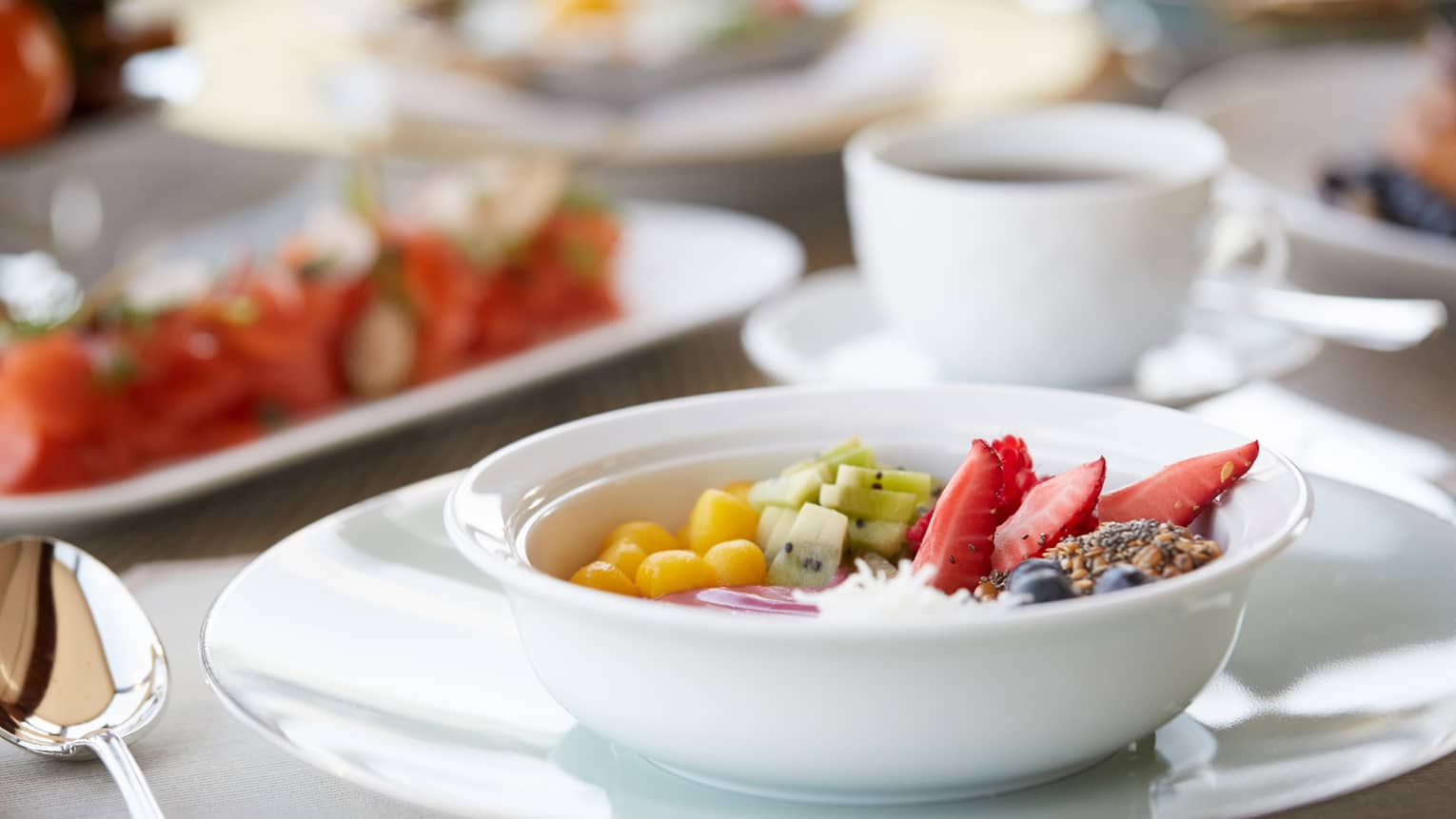 White bowl with fresh fruit, granola on in-room dining tray