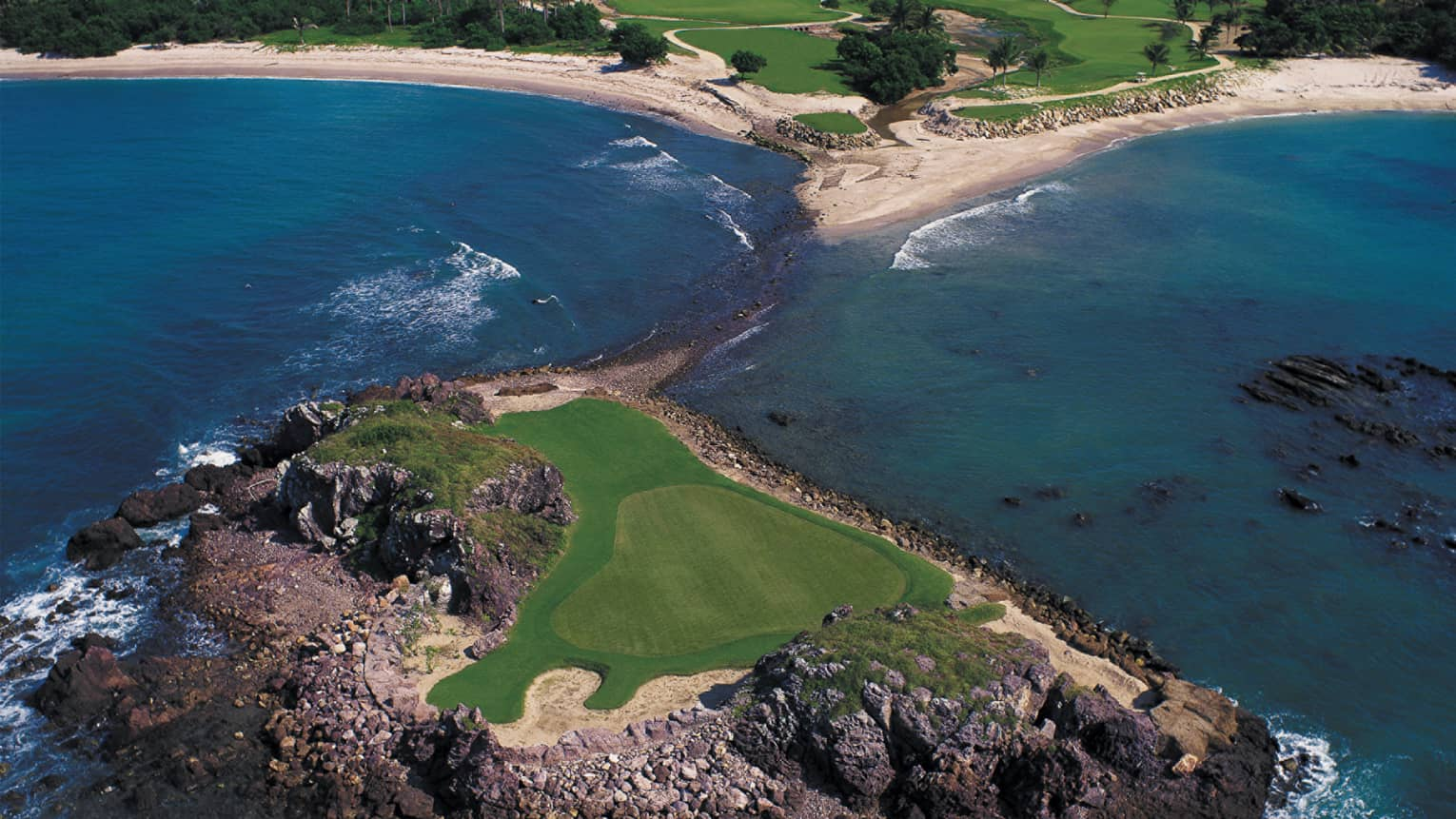 Aerial view of natural island green golf course Tail of the Whale, ocean on each side