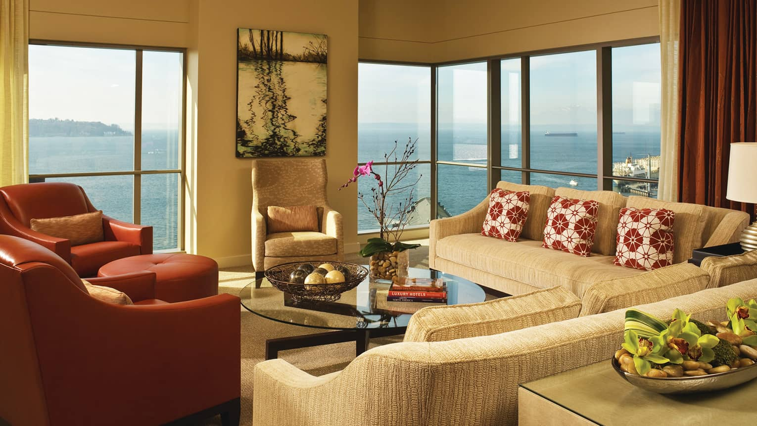 Presidential Suite sofas, red leather armchairs in front of corner windows with bay views