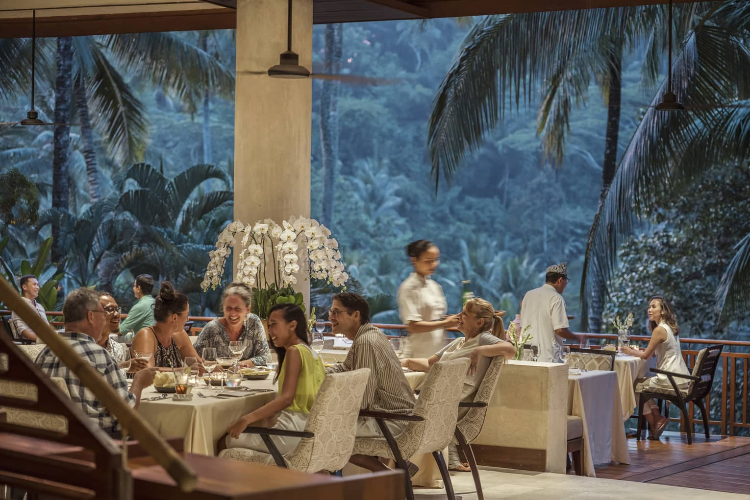 Ayung Terrace open air restaurant dining room surrounded by large palms