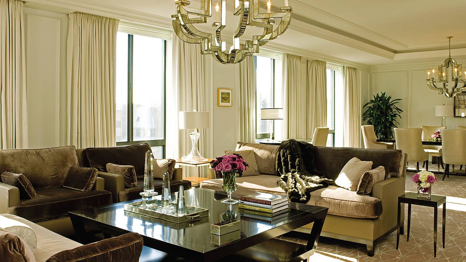 Presidential Suite West Wing large living room with brown, beige velvet sofas, bright picture windows