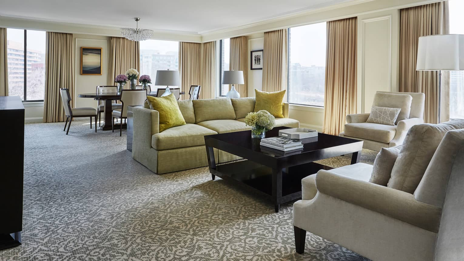 Presidential Suite East Wing dining table, living room with side of yellow sofa, two white armchairs