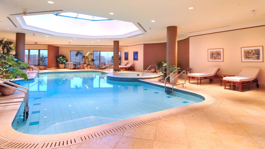 Indoor swimming pool with domed glass ceiling and skylight