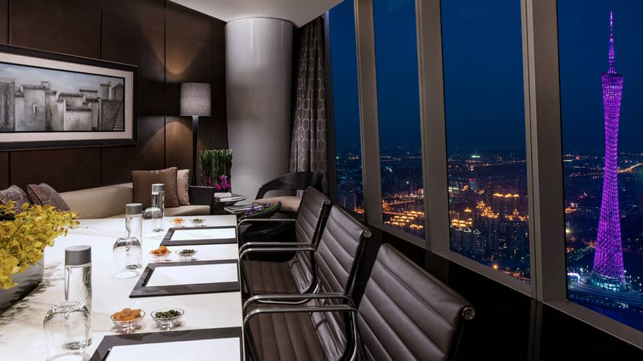 Executive Club private meeting table and sofa by window on 99th floor of hotel at night