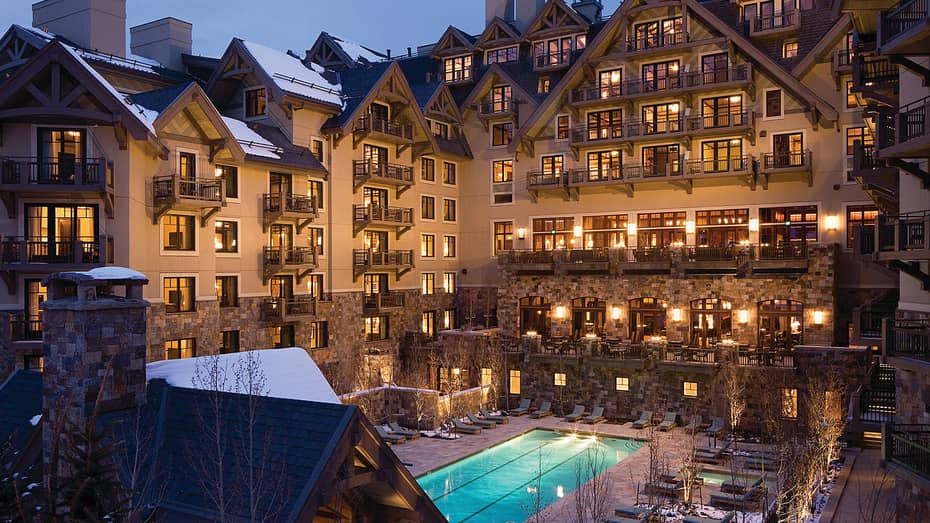 Four Seasons Vail Hotel Exterior At Night With Lit Windows And Balconies Glowing Blue Outdoor