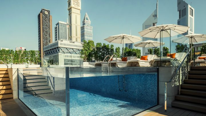 Dubai hotel with a glass pool rooftop pool four for Pool design dubai