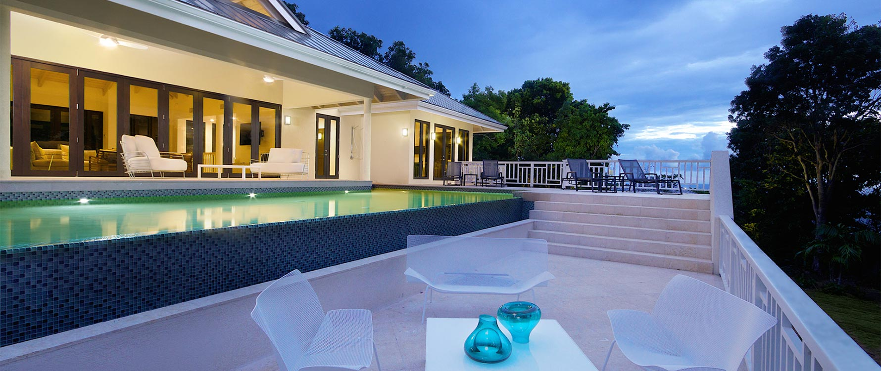 View from pool with outdoor sitting area