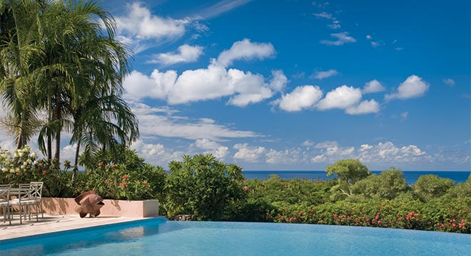 Only a seven-minute golf-cart ride to the beach, these traditional island homes are set higher on Nevis Peak, giving you stunning sunset views over the Caribbean Sea.
